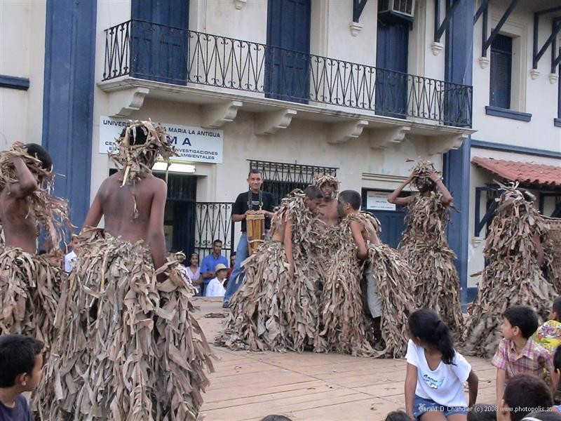 Los Santos dancers wearing slave clothes made of banana leaves