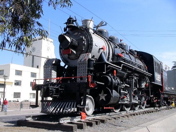 Railroad Engine in front of Closed Train Station